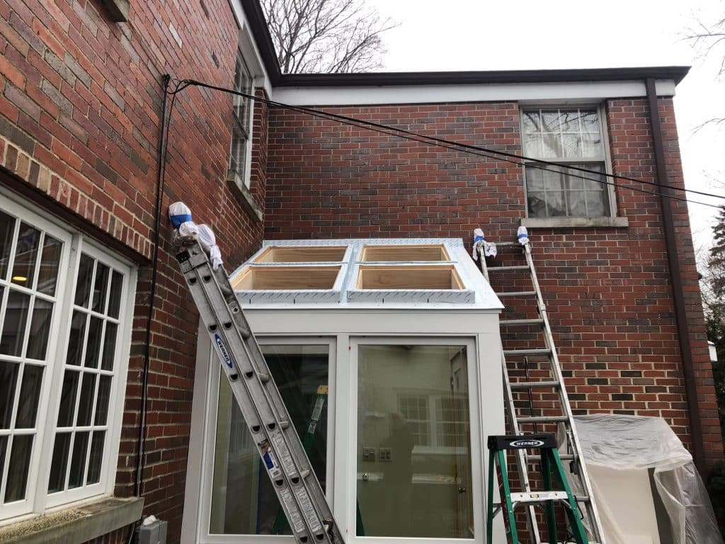 Window and skylight installation helped the space look and feel open